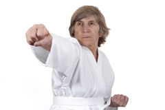 Retired woman practicing self defence Royalty Free Stock Images