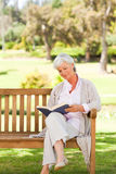 Retired woman reading a book Royalty Free Stock Photography