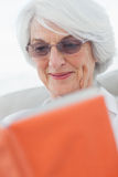 Retired woman reading a book Royalty Free Stock Photo