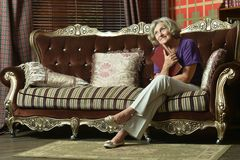 Retired woman reading book Royalty Free Stock Image