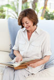 Retired woman reading her book Stock Photography
