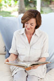 Retired woman reading her book Royalty Free Stock Photography
