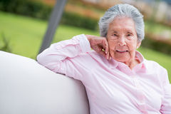 Retired woman relaxing outdoors Stock Images