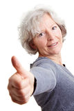 Retired woman showing thumbs up Royalty Free Stock Photo