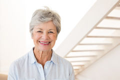 Retired woman smiling at the camera Royalty Free Stock Photography