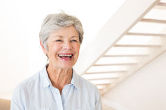 Retired woman smiling and laughing Royalty Free Stock Photos