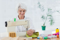 Retired woman using the sewing machine Royalty Free Stock Photography