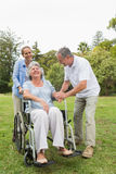 Retired woman in wheelchair with husband and daughter Stock Photos
