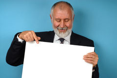 Retired worker with copy space. Retired older man holding up poster board that is ready for text Stock Photos