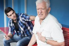 Retiree with chest pain Stock Image