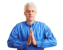 Retiree doing meditation Royalty Free Stock Photos