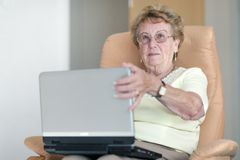 Retiree with a laptop Stock Photography