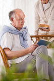 Retiree reading book Royalty Free Stock Photo