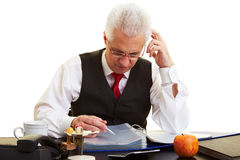 Retiree reading files Royalty Free Stock Photography