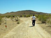 Retiree Walking in Desert - Horizontal Royalty Free Stock Photo