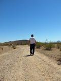 Retiree Walking in Desert - Vertical Stock Image