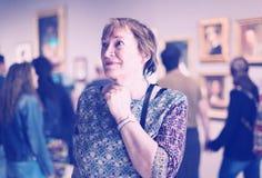 Retiree woman in art museum Stock Image