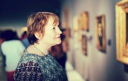 Retiree woman in art museum Stock Photos