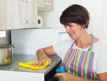 Retiree woman cleaning home Stock Photo