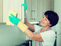 Retiree woman cleaning home Royalty Free Stock Photos