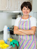 Retiree woman cleaning home Stock Photos