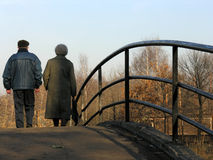 Retirees on bridge. Back retirees on bridge Royalty Free Stock Images