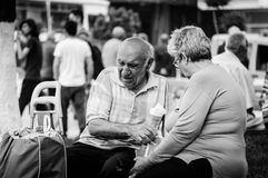 Retirees Sitting On The Town Center Royalty Free Stock Photography