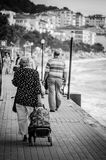 Retirees Walking On The Seaside Stock Photos