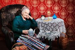 Retirement. Portrait of a smiling senior woman having a rest at home Royalty Free Stock Images