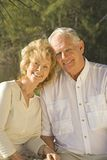 Retirement. Happy senior couple sitting in a park Royalty Free Stock Photography