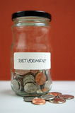 Retirement. Savings in glass jar with quarters, dimes, nickels, and pennies Stock Photos