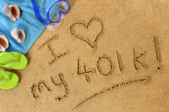 401k retirement plan beach writing love happiness concept. Retirement beach background with towel and flip flops and words written in sand Stock Photography