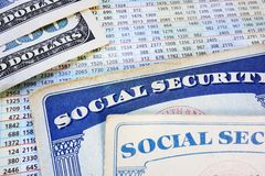 Retirement benefits. Social Security cards with cash and benefit amount numbers stock images