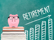 Retirement chart and piggy bank. Piggy bank and blackboard on white Stock Photo