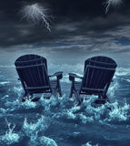 Retirement Crisis. Concept as a couple of adirondack chairs sinking in the ocean during a thunder storm as a metaphor for financial investment problems for Stock Photos