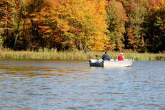 Retirement fishing in the fall. Retired couple enjoy fall fishing Stock Photos