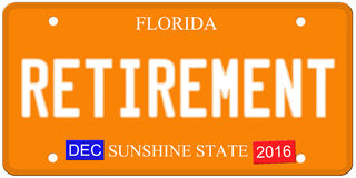 Retirement Florida License Plate. An imitation Florida license plate with December 2016 stickers and RETIREMENT written on it making a great concept.  Words on Royalty Free Stock Photography