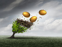 Retirement Fund Crisis. Concept as a tree in peril with a nest and gold eggs falling out during a destructive thunder storm as a metaphor for financial Stock Photo