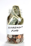 Retirement Fund Money In Jar. Cash money from a retirement fund is in a glass jar Stock Image