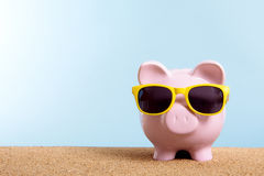 Retirement fund, travel money concept, Piggy Bank on summer beach vacation, copy space Stock Photos