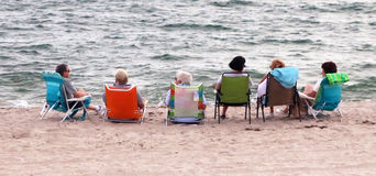 Retirement. A group of senior citizens relaxing and socializing at the beach of Deerfield Beach,Florida Royalty Free Stock Photography