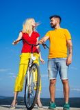 Retirement. Happy funny young couple riding on bicycle. Young riders enjoying themselves on trip. summer holidays - love. Romance and people concept stock photo
