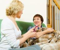 Retirement home employee offering  mixture to patient Stock Photos
