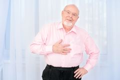 Retirement at home. Happy smiling old man having a rest at home. Retirement royalty free stock photos