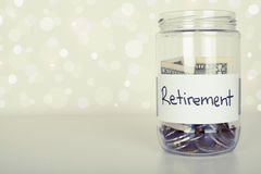 Retirement. Jar on right and copy space on left of the image Stock Photography