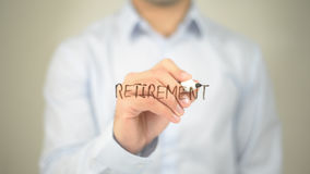 Retirement  , man writing on transparent screen Stock Images