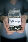 Retirement. Note on money jar Royalty Free Stock Photography