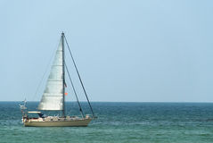 Retirement in Paradise. You've finally achieved it! Retirement on a sailboat in paradise Stock Photo