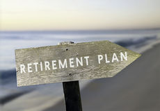 Retirement. Pastel toned image of 'retirement plan'wooden sign on blurred beach background Royalty Free Stock Photo