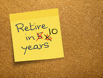 Retirement - pension delay, sticky note on cork Royalty Free Stock Image